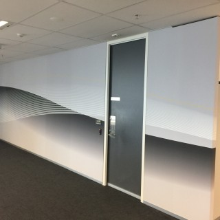 Simple yet effective office graphics running the length of the wall