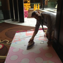 Whatever it takes, ironing fabric banners before installing